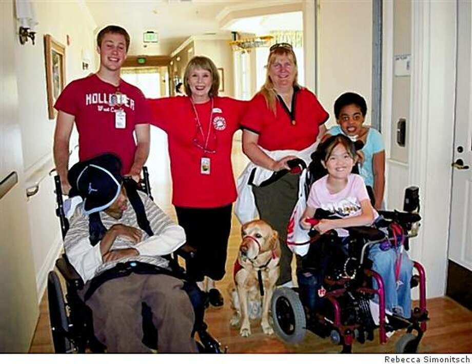 Carol Weldon is second from left, with Trevin on one of his visits to George Mark Children's House, the only free-standing pediatric hospice, end stage life and respite care facility in the United States. Photo: Rebecca Simonitsch