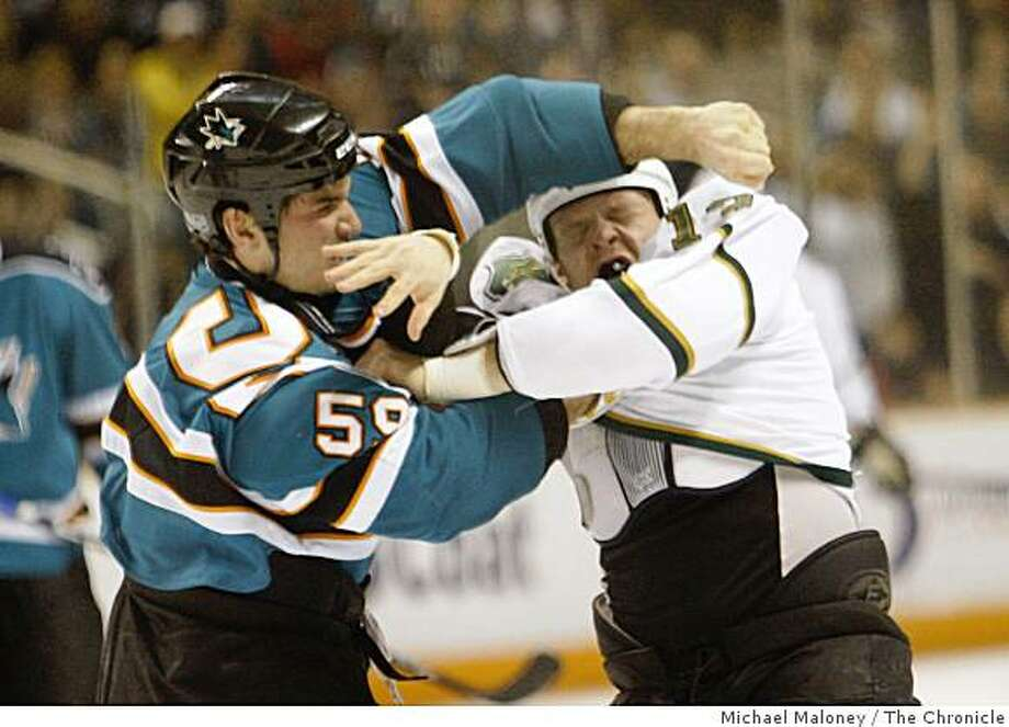 San Jose Sharks Brad Stauvitz (59) and Dallas Stars Krystofer Barch (right) fight in the 1st period at the HP Pavilion in San Jose, Calif., on March 3, 2009. Photo: Michael Maloney, The Chronicle