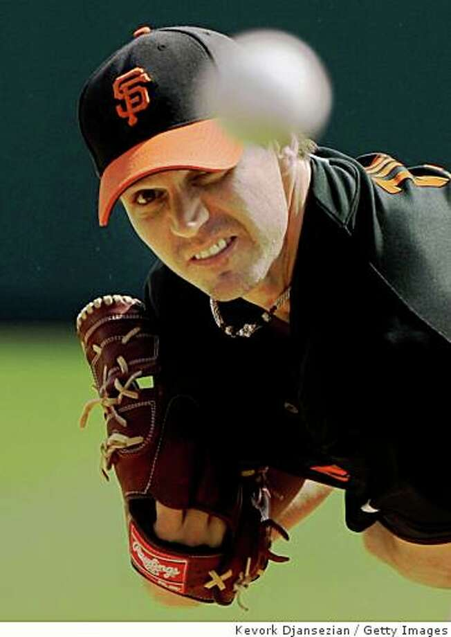 GLENDALE, AZ - MARCH 04: Barry Zito #75 of the San Francisco Giants follows through on a pitch as he warms up before the start of a spring training game against the Los Angeles Dodgers on March 4, 2009, in Glendale, Arizona.  (Photo by Kevork Djansezian/Getty Images) Photo: Kevork Djansezian, Getty Images