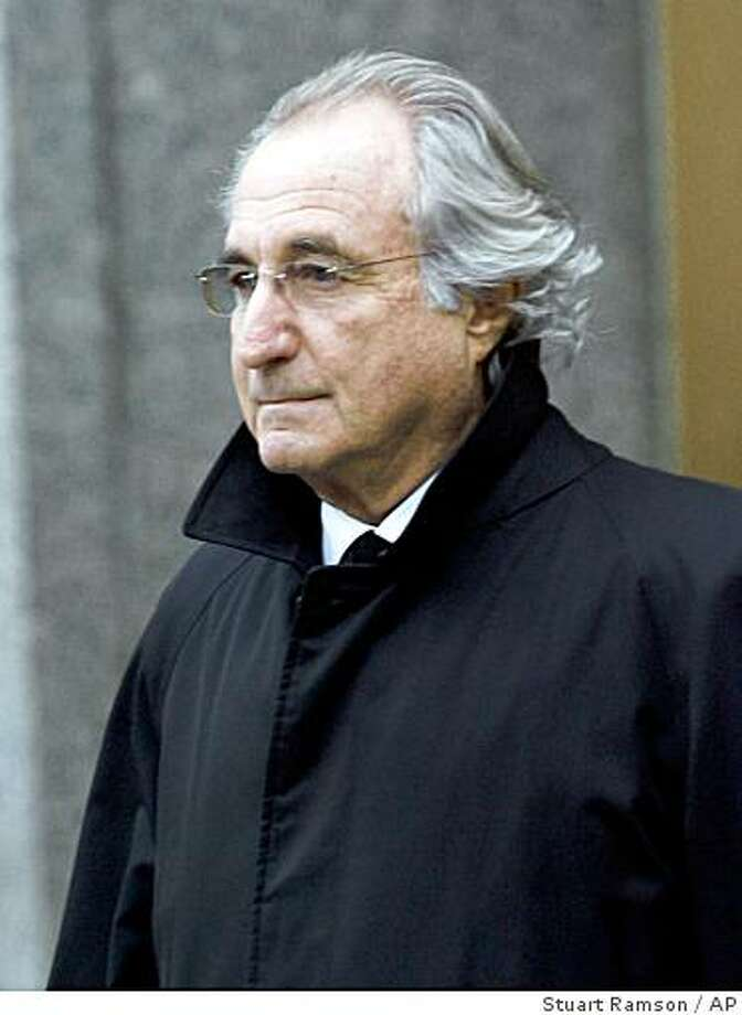 ** FILE ** In this Wednesday, Jan. 14, 2009 file photo, Bernard L. Madoff, the accused mastermind of a $50 billion Ponzi scheme, leaves Federal Court in New York. Madoff is seeking to keep a $7 million Manhattan penthouse and an additional $62 million in assets, saying they are unrelated to the fraud that authorities say cost victims more than $50 billion. (AP Photo/Stuart Ramson, file) Photo: Stuart Ramson, AP
