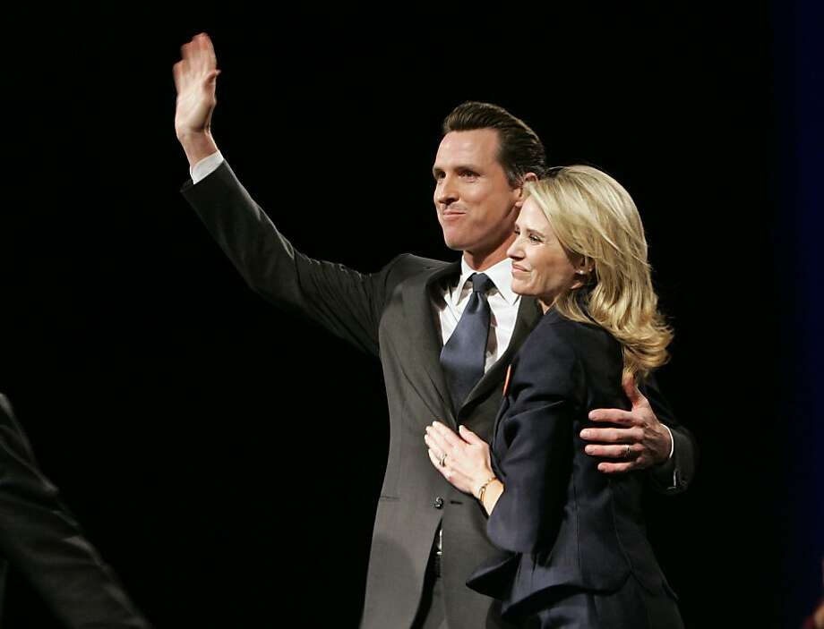 "FILE - In this file photo from April 25, 2009, San Francisco Mayor Gavin Newsom waves to the crowds as he hugs his wife, Jennifer Siebel Newsom, after speaking at the California Democratic Party Convention in Sacramento, Calif. Newsom, who propelled the debate over gay marriage but struggled to find a popular message outside the San Francisco Bay area, has dropped his bid for California governor. A statement issued Friday by his campaign said he was unable to devote the time needed to run an effective campaign, citing ""a young family and responsibilities at City Hall."" (AP Photo/Rich Pedroncelli, file) Photo: Rich Pedroncelli, AP"
