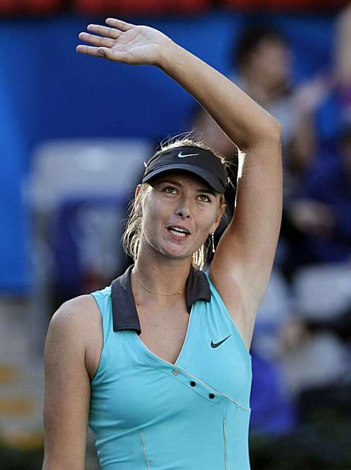 Maria Sharapova of Russia waves to the spectators after she defected Tsvetana Pironkova of Bulgaria in their first round of China Open Tennis Tournament in Beijing, China Sunday, Oct. 3, 2010. Sharapova won 6-4, 7-6. Photo: Andy Wong, AP