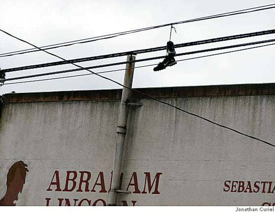shoes on a wire in front of abraham lincoln high school in s.f. Photo: Jonathan Curiel