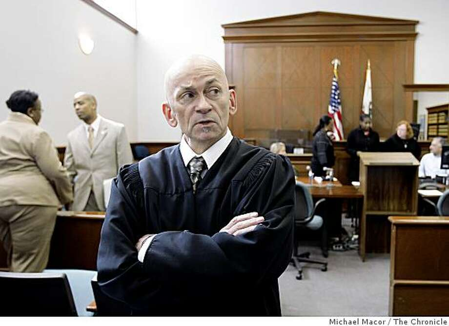 Commissioner Ron Albers runs the Community Justice Center Court that prosecutes quality-of-life crimes like petty drug offenses, graffiti and prostitution. Albers has been hearing cases for just the past three days since the program began in San Francisco, Calif. Albers in court on Wednesday Mar. 4, 2009, when 5 defendants were scheduled to appear and face their charges but none appeared today. Photo: Michael Macor, The Chronicle