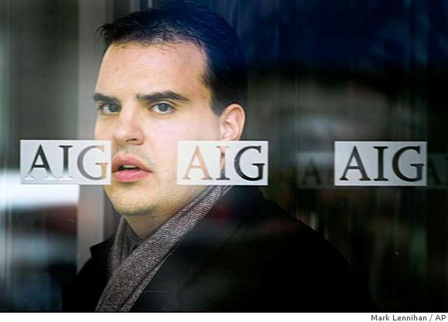 A man leaves AIG offices in New York Monday, March 2, 2009. American International Group Inc., once the world's largest insurer, said Monday it lost $61.7 billion in the fourth quarter, the biggest quarterly loss in U.S. corporate history, amid continued financial market turmoil. (AP Photo/Mark Lennihan) Photo: Mark Lennihan, AP