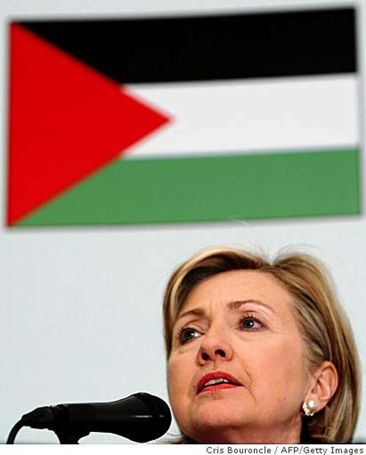 US Secretary of State Hillary Clinton speaks in front of a Palestinian flag during a press conference following an international donors meeting for rebuilding the Gaza Strip, in the Egyptian Red Sea resort town of Sharm el-Sheikh on March 2, 2009. Clinton called for all sides in the Gaza conflict to work towards a durable ceasefire and condemned continued rocket attacks on Israel. AFP PHOTO/CRIS BOURONCLE (Photo credit should read CRIS BOURONCLE/AFP/Getty Images) Photo: Cris Bouroncle, AFP/Getty Images