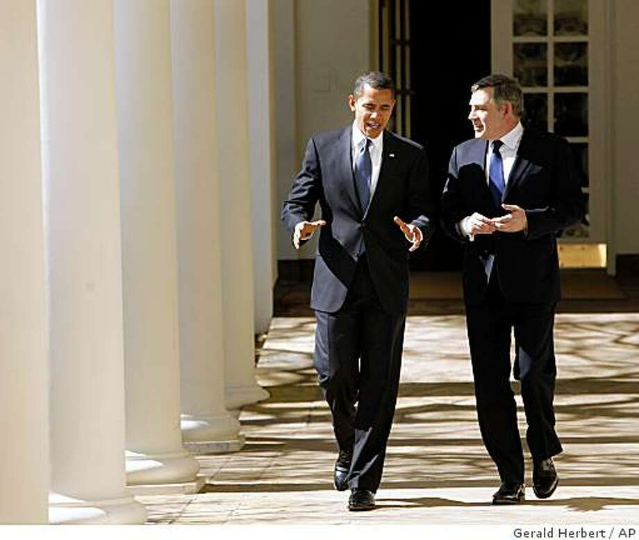 President Barack Obama walks down the Colonnade of the White House in Washington, Tuesday, March 3, 2009, with British Prime Minister Gordon Brown. (AP Photo/Gerald Herbert) Photo: Gerald Herbert, AP