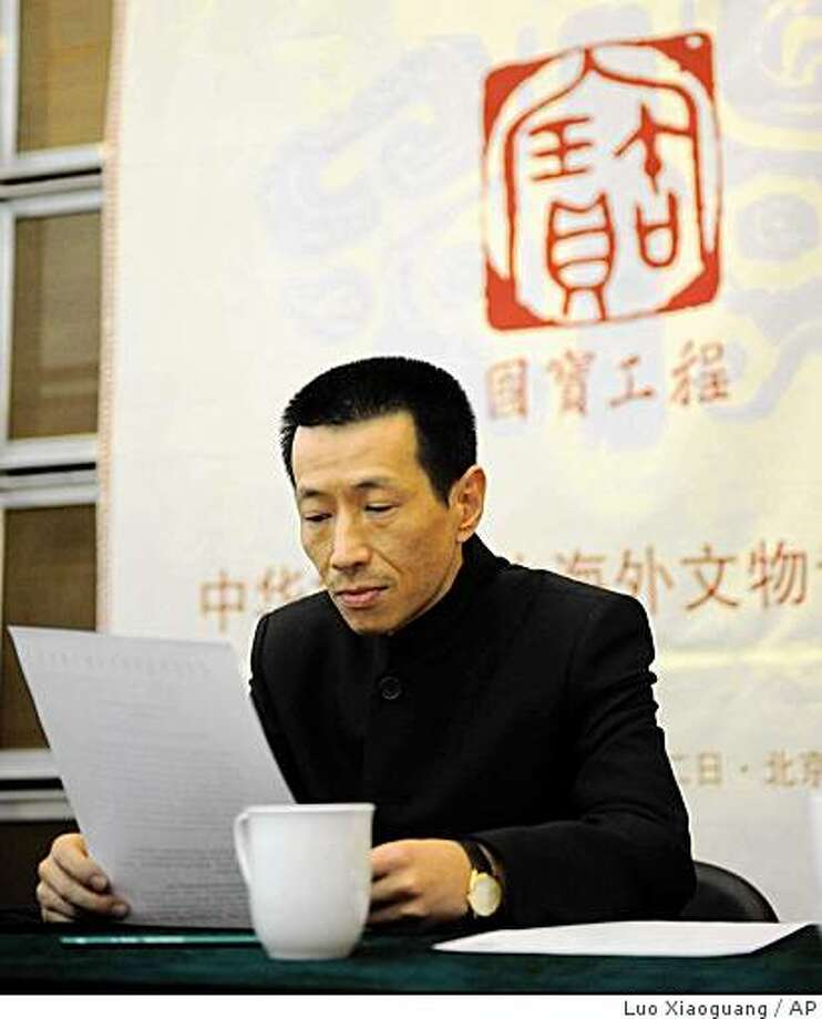 In this photo released by China's Xinhua News Agency, Cai Mingchao, a collection advisor of National Treasures Fund who successfully bid for two looted bronze sculptures auctioned in Paris last week, attends a news conference in Beijing Monday, March 2, 2009. (AP Photo/Xinhua, Luo Xiaoguang) Photo: Luo Xiaoguang, AP