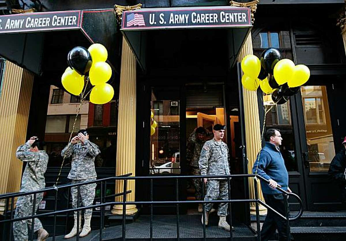 NEW YORK - DECEMBER 17: (FILE PHOTO) US Army soldiers walk out of the Army's City Hall Recruiting Station December 17, 2009 in lower Manhattan in New York. The Defense Department ordered military recruiters October 19, 2010 to accept openly gay recruitsand to suspend enforcement of the