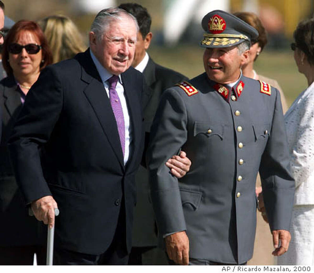 **FILE** Army Commander in Chief Lt. Gen. Ricardo Izurieta escorts Gen. Augusto Pincohet, left, upon his arrival to the Air Force base at the Pudahuel airport in Santiago, Chile in this March 3, 2000 file photo. Pinochet, who overthrew Chile's democratically elected Marxist president in a bloody coup and ruled this Andean nation for 17 years, died Sunday, Dec. 10, 2006 of complications following a heart attack. He was 91. (AP Photo/Ricardo Mazalan, File)