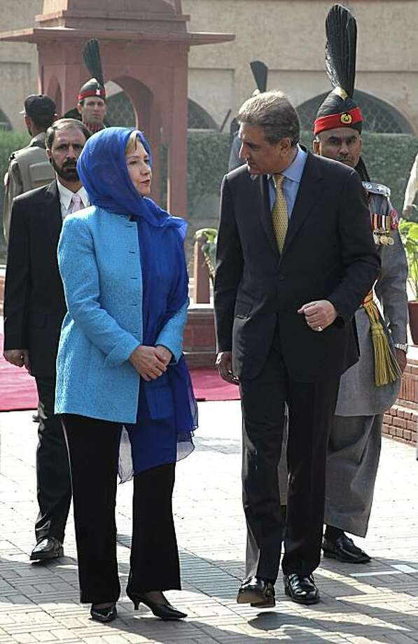 File - In this Oct. 29, 2009 file photo Secretary of State Hillary Rodham Clinton, left, walks beside Pakistani Foreign Minister Shah Mehmood Qureshi, at the Iqbal Memorial in Lahore, Pakistan. The U.S. and Pakistan will try in high-level talks this weekto smooth over tensions that have risen over recent American military action near the border with Afghanistan and persistent allegations that Islamabad is not doing enough to target Taliban militants based on its territory. Photo: Mansoor Ahmed, AP