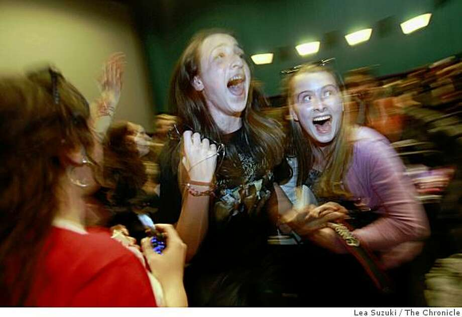 "Emma Herlihy, 14 (center) and Ina Herlihy, 16 (right) both of San Francisco react after the Jonas Brothers greeted fans at the Century San Francisco Centre 9 theater before their movie  ""Jonas Brothers The 3D Concert Experience"" is shown in San Francisco, Calif. on Sunday, March 1, 2009. Photo: Lea Suzuki, The Chronicle"