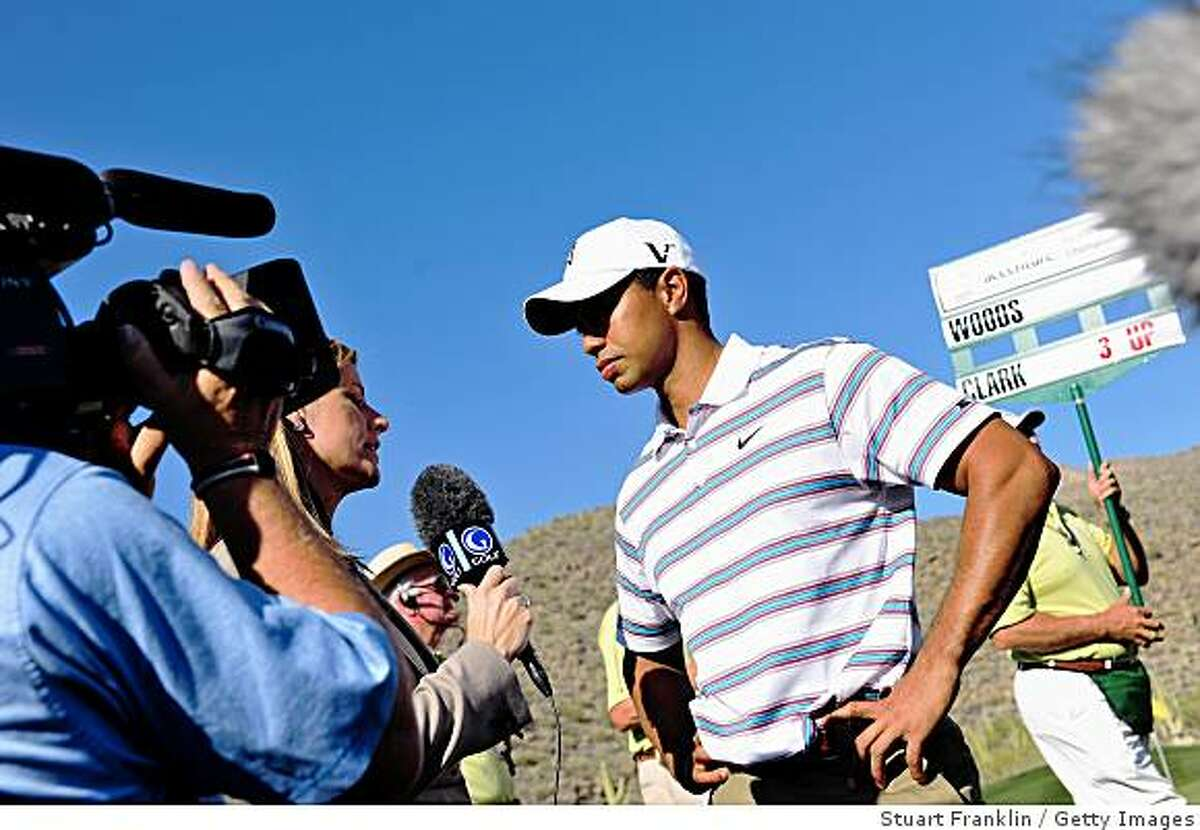 MARANA, AZ - FEBRUARY 26: Tiger Woods of USA is interviewed after loosing his match on the 16th hole during the second round of Accenture Match Play Championships at Ritz - Carlton Golf Club at Dove Mountain on February 26, 2009 in Marana, Arizona. (Photo by Stuart Franklin/Getty Images)