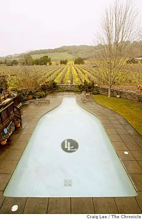 A wine bottle swimming pool which is really used as a required back up water supply for fire fighting at the Limerick Lane winery taste room in Healdsburg, Calif., on January 23, 2009. Photo: Craig Lee, The Chronicle