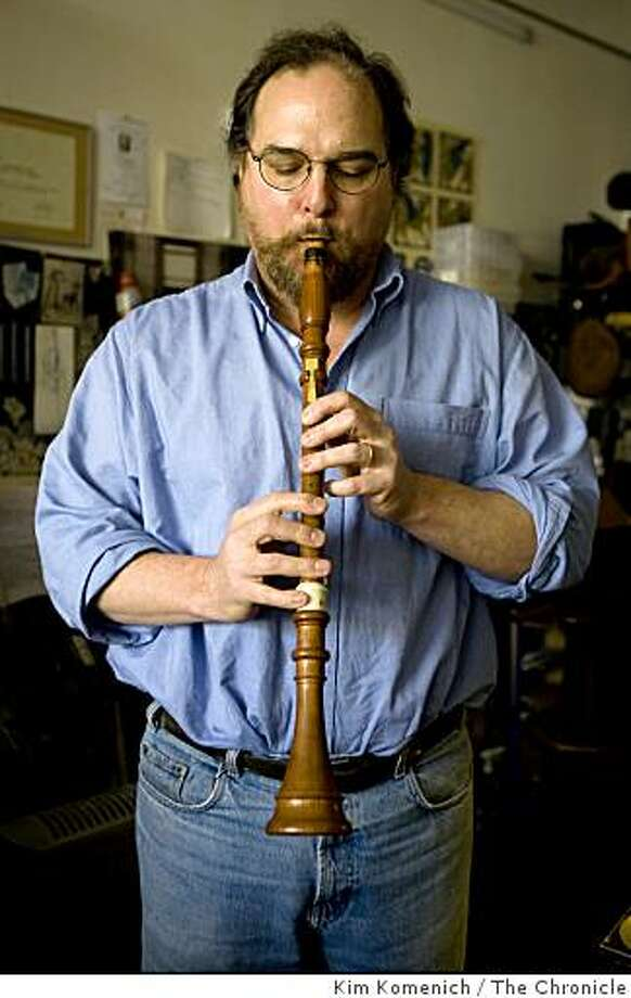 Daniel Deitch plays a baroque clarinet in his workshop in San Francisco, Calif., on Wednesday, Feb. 4, 2009. Deitch builds baroque flutes when he's not repairing and restoring contemporary woodwind instruments. Photo: Kim Komenich, The Chronicle