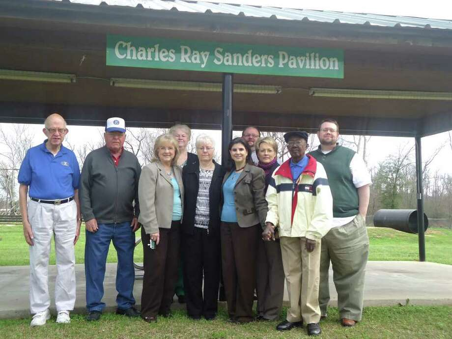 Members of the Jasper Kiwanis Club joined together to dedicate a pavilion at the Jasper Kiwanis Park to the late Charles Ray Sanders in the presence of his wife, Kay Sanders