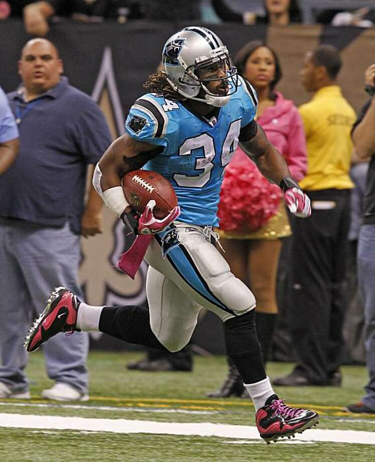 Carolina Panthers running back DeAngelo Williams (34) heads for the endzone in an NFL football game against the New Orleans Saints in New Orleans, Sunday, Oct. 3, 2010. Williams scored on the play but the Panthers lost 16-14. Photo: Bill Haber, AP