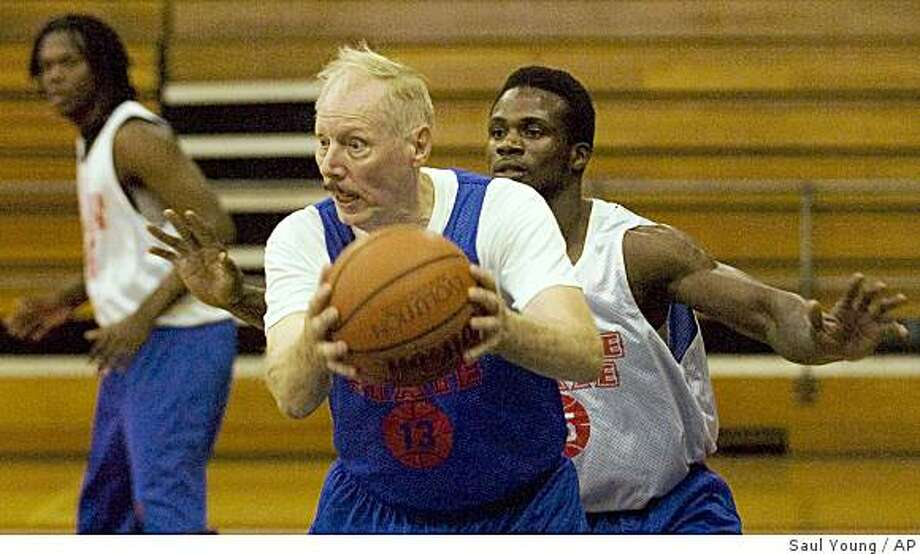 In this Oct. 1, 2008 photo, Roane State basketball player Ken Mink, 73, is guarded by teammate Camille Ngon a' Ngon during basketball practice at Roane State Community College's gym in Harriman, Tenn. (AP Photo/Knoxville News Sentinel, Saul Young) ** MANDATORY CREDIT, TV OUT, MAGS OUT, ONLINE USE AP MEMBERS ONLY, NO SALES * Photo: Saul Young, AP