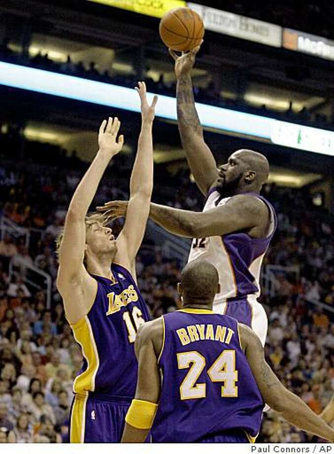 Phoenix Suns center Shaquille O'Neal, top right, shoots over Los Angeles Lakers center Pau Gasol, top left, of Spain, as Lakers guard Kobe Bryant, bottom, looks on in the first quarter of an NBA basketball game Sunday, March 1, 2009, in Phoenix. (AP Photo/Paul Connors) Photo: Paul Connors, AP