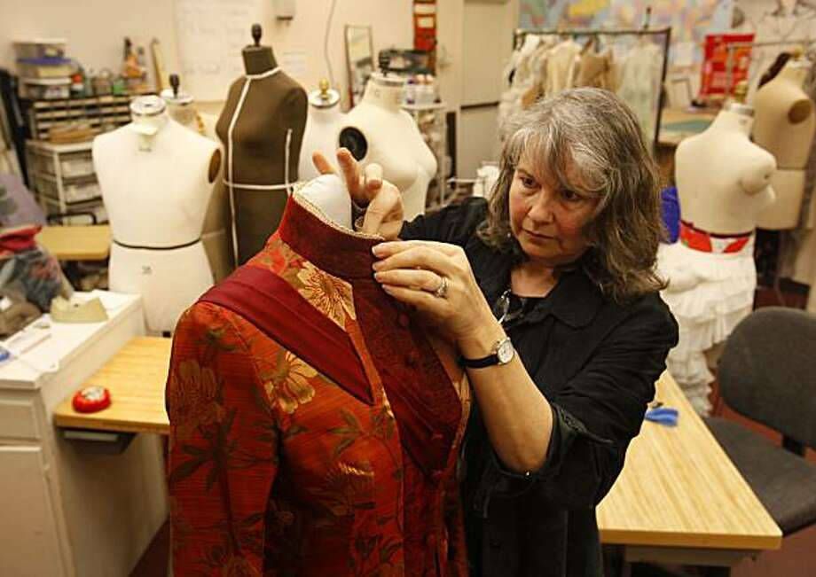 """Kitty Muntzel a draper in the costume shop of the Berkeley Repertory Theatre shows off a dress she made on February 25, 2009 which is in the current production, """"In the Next Room"""". Photo: Michael Maloney, The Chronicle"""