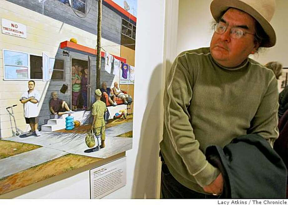 "Artist Francisco Dominguez looks over the artwork of Sandow Birks', "" GI Homecoming"",  from the new exhibit ""Hobos to Street People,"" at the California Historical Society, Thursday Feb. 19, 2009, in San Francisco, Calif. Photo: Lacy Atkins, The Chronicle"