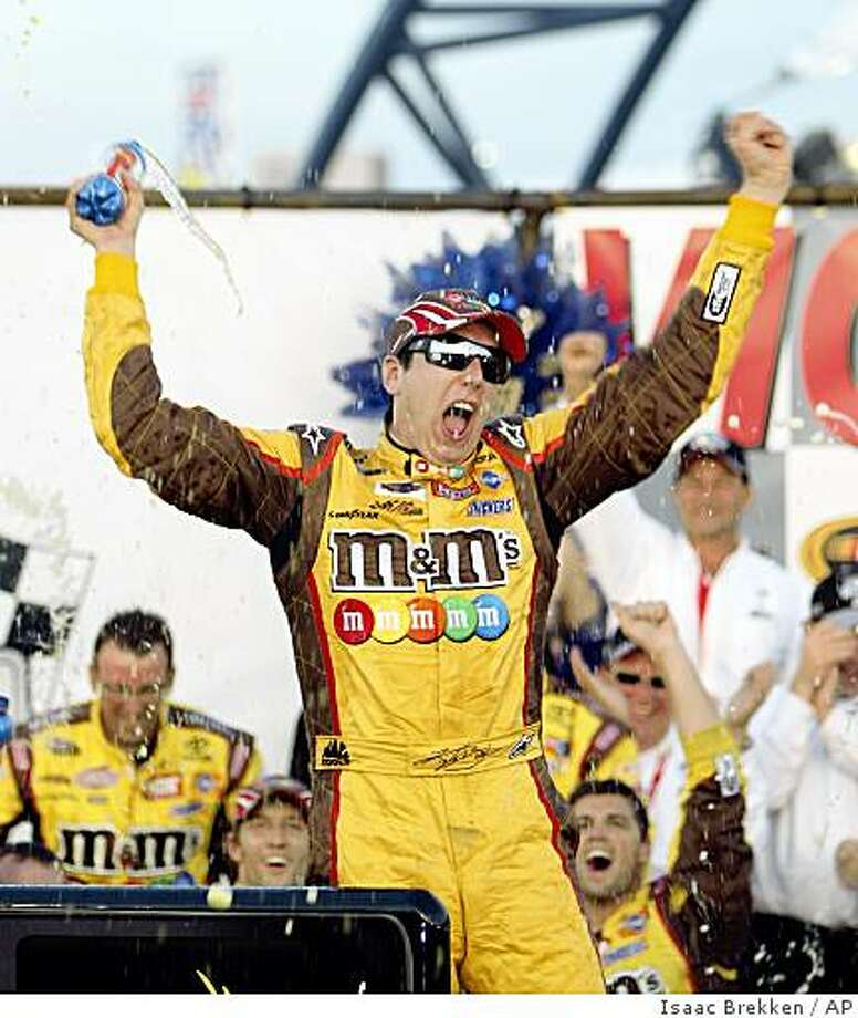 Kyle Busch celebrates his victory in the NASCAR Shelby 427 auto race at Las Vegas Motor Speedway in Las Vegas on Sunday, March 1, 2009. (AP Photo/Isaac Brekken) Photo: Isaac Brekken, AP