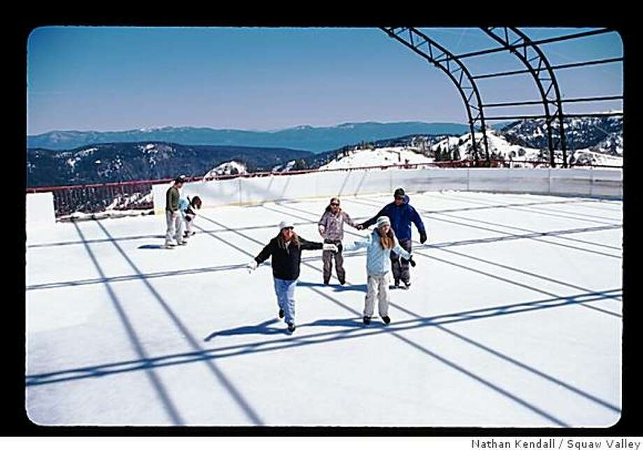 The ice rink at High Camp at Squaw Valley. Lake Tahoe is visible in the background. Photo: Nathan Kendall, Squaw Valley