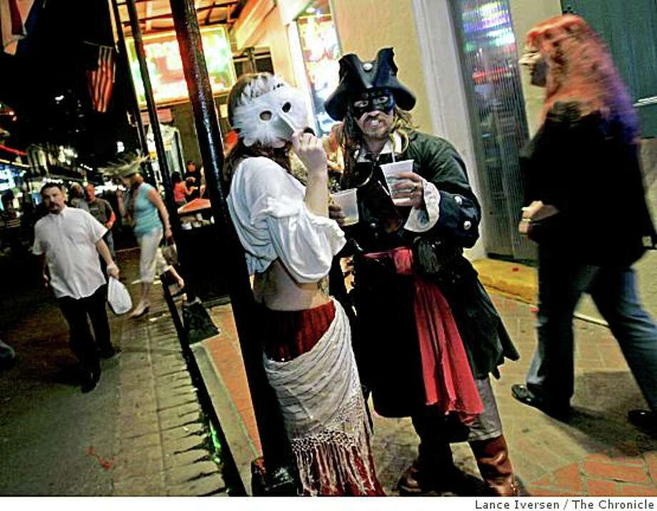 A pirate and his maid stop for a drink on Bourson Street after taking part in the Pirate Parade through the French Quarter in New Orleans. Photo: Lance Iversen, The Chronicle