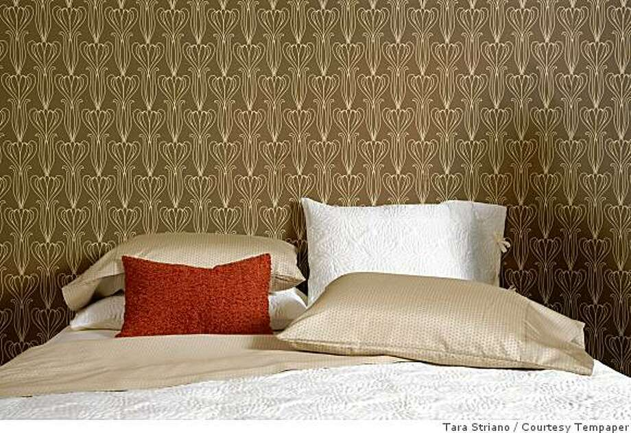 Tempaper, a repositionable. self-adhesive washable vinyl wallpaper called by LolliProps Inc. in New York. is used to decorate this room. Tempaper designs are mostly modern adaptations of Art Nouveau patterns. This version is called Bela. Photo: Tara Striano, Courtesy Tempaper