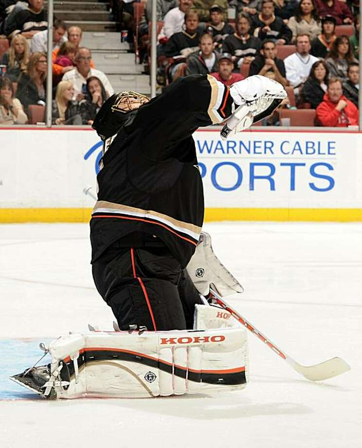 ANAHEIM, CA - OCTOBER 17:  Jonas Hiller #1 of the Anaheim Ducks makes a shoulder save against the Phoenix Coyotes during the second period at the Honda Center on October 17, 2010 in Anaheim, California. Photo: Harry How, Getty Images