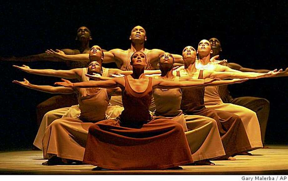 """The Alvin Ailey American Dance Theater perform """"Revelations!"""" at the Detroit Opera House in Detroit on Saturday, Feb. 14, 2009. The Ailey troupe is currently in the midst of a 50-city global tour, celebrating its 50th anniversary. (AP Photo/Gary Malerba) Photo: Gary Malerba, AP"""