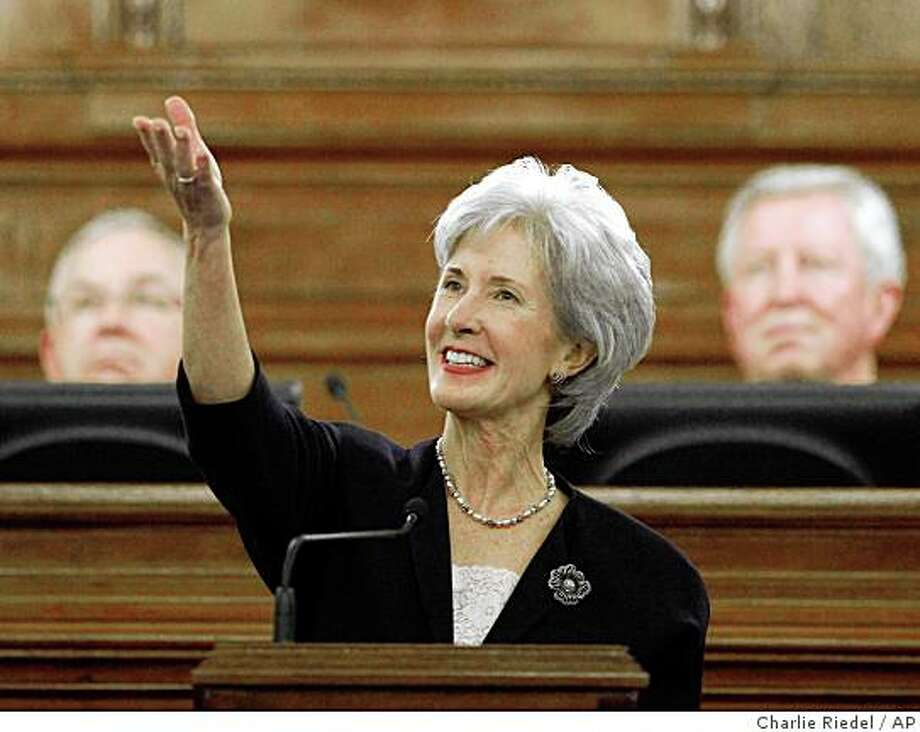 ** FILE ** In this Jan. 12, 2009 file photo, Kansas Gov. Kathleen Sebelius, flanked by House Speaker, Mike O'Neal, left, and Senate President Steve Morris, delivers her State of the State address in the statehouse in Topeka, Kan.  Sebelius is President Barack Obama's choice for secretary of health and human services, a White House source said Saturday, adding that Obama is expected to formally announce the nomination on Monday.  (AP Photo/Charlie Riedel, File) Photo: Charlie Riedel, AP
