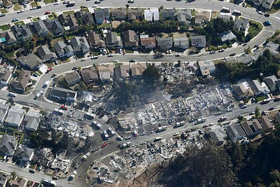A large section of a neighborhood lies in ruins in San Bruno, Calif. on Friday, Sept. 10, 2010 after a massive natural gas pipeline explosion Thursday night. Photo: Paul Chinn, The Chronicle