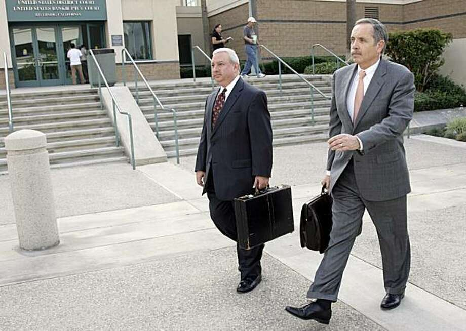 "Attorney Dan Woods, right, leaves the United States District Court in Riverside, Calif., after making arguments on the U.S. military's ""Don't Ask, Don't Tell"" policy on Monday, Oct. 18, 2010. Woods represents the plaintiffs, the Log Cabin Republicans. Photo: Francis Specker, AP"