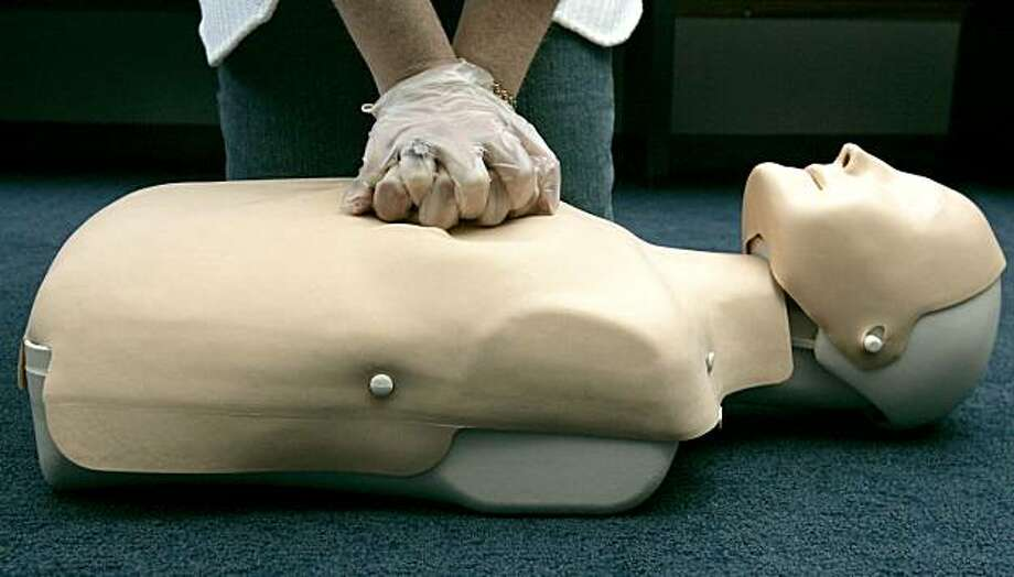 FILE - In this Sept. 15, 2006 file photo, a person participates in an American Red Cross CPR training in Washington. A new study finds bystanders saved more lives using hands-only CPR than those using traditional CPR with mouth-to-mouth breathing. Photo: Harzan N. Ghanbari, AP