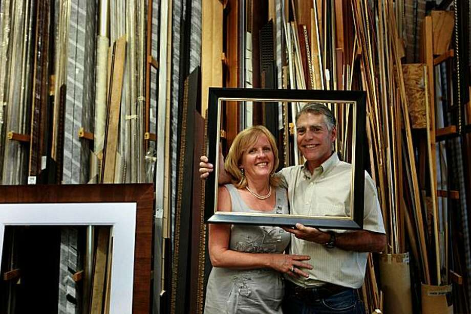 Janet Martin (left) and her husband Carl Martin (right) together in The Studio Shop Annex, a framing studio in Burlingame, Calif., on Wednesday, October 13, 2010.  Their business started at The Studio Shop which is the oldest retail business in Burlingame, and contributes to local art-in-school programs and exhibitions. Photo: Liz Hafalia, The Chronicle