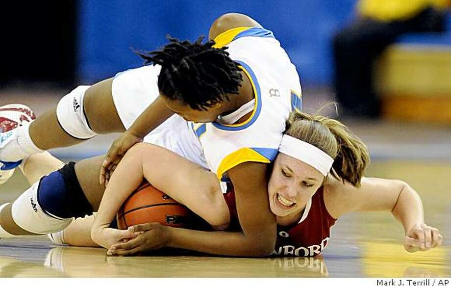 UCLA's Christina Nzekwe, left, and Stanford's Kayla Pedersen battle for a loose ball during the first half of their NCAA college basketball game, Friday, Feb. 27, 2009, in Los Angeles. (AP Photo/Mark J. Terrill) Photo: Mark J. Terrill, AP