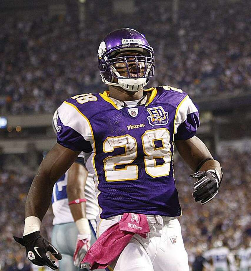 Minnesota Vikings running back Adrian Peterson (28) celebrates his third quarter touchdown during their NFL football game against the Dallas Cowboys, Sunday, Oct. 17, 2010, in Minneapolis. Photo: Andy King, AP