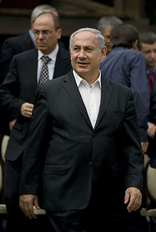 Israel's Prime Minister Benjamin Netanyahu arrives at a special cabinet meeting in kibbutz Degania Alef in the the Jordan Valley, northern Israel, Sunday, Oct. 17, 2010. Deputy Prime Minister Silvan Shalom walks behind Netanyahu. Netanyahu on Sunday confirmed that negotiations with the Palestinians about a much-anticipated swap for a captured Israeli soldier have resumed. Photo: Ariel Schalit, AP