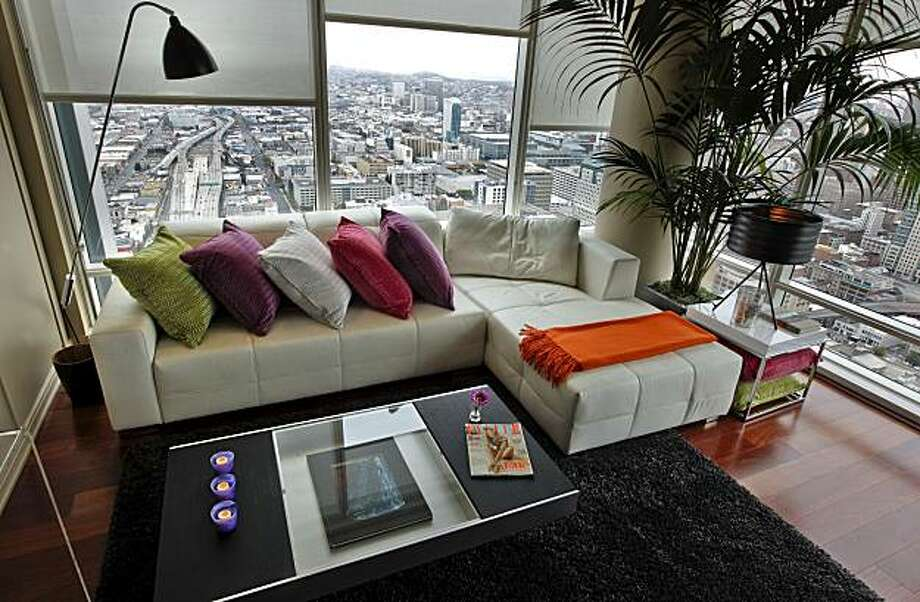 Living room and view from the 47th floor. Nicky Summer a renowned London designer has been given the task of decorating a home in One Rincon Hill in San Francisco, Ca., for an international jet-setter. Photo: Michael Macor, The Chronicle