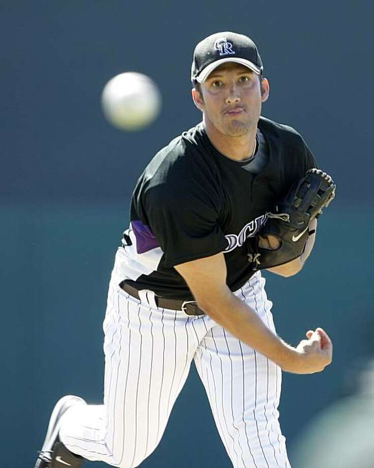 Colorado Rockies pitcher Huston Street throws against the Chicago White Sox, Thursday, Feb. 26, 2009, during a spring training baseball game in Tucson, Ariz. (AP Photo/Elaine Thompson) Photo: Elaine Thompson, AP