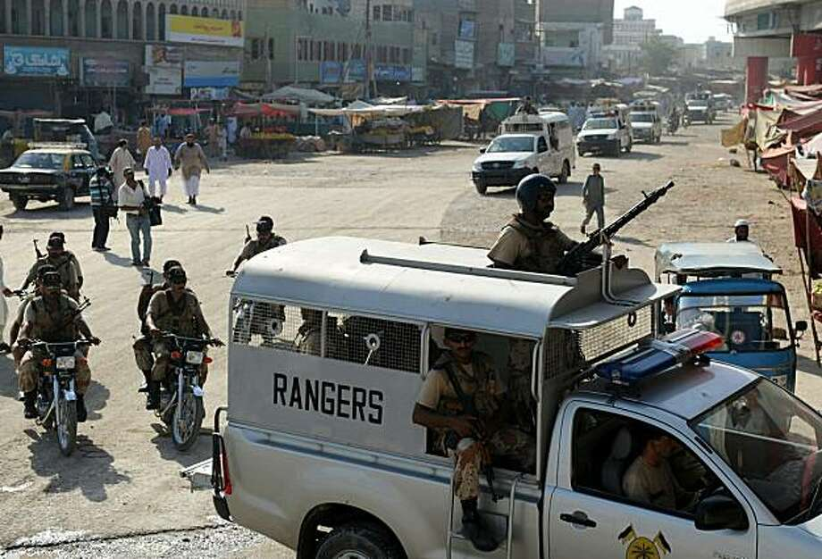Pakistani paramilitary solders patrol the streets of Karachi on October 17, 2010. At least 21 people have been killed in a fresh bout of political violence ahead of a key by-election in Pakistan's southern port city of Karachi, a senior police official said. Photo: Asif Hassan, AFP/Getty Images