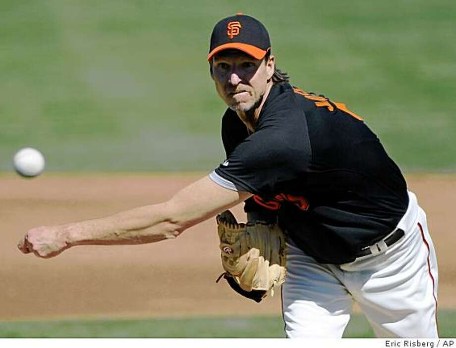 San Francisco Giants starting pitcher Randy Johnson throws against the Kansas City Royals in the first inning of their spring training baseball game in Scottsdale, Ariz., Friday, Feb. 27, 2009. (AP Photo/Eric Risberg) Photo: Eric Risberg, AP