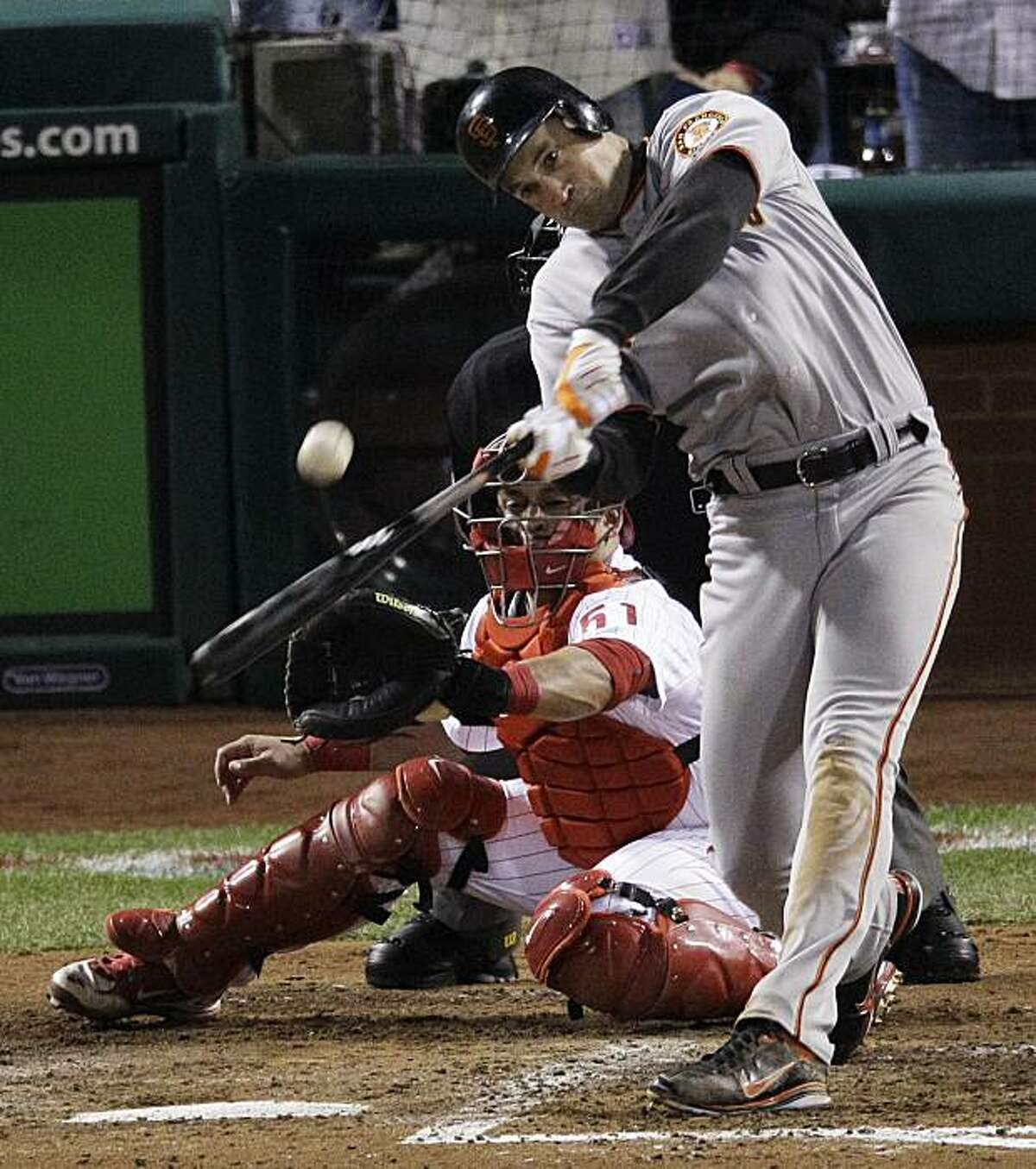 San Francisco Giants' Pat Burrell hits a run-scoring double during the sixth inning of Game 1 of baseball's National League Championship Series against the Philadelphia Phillies Saturday, Oct. 16, 2010, in Philadelphia.