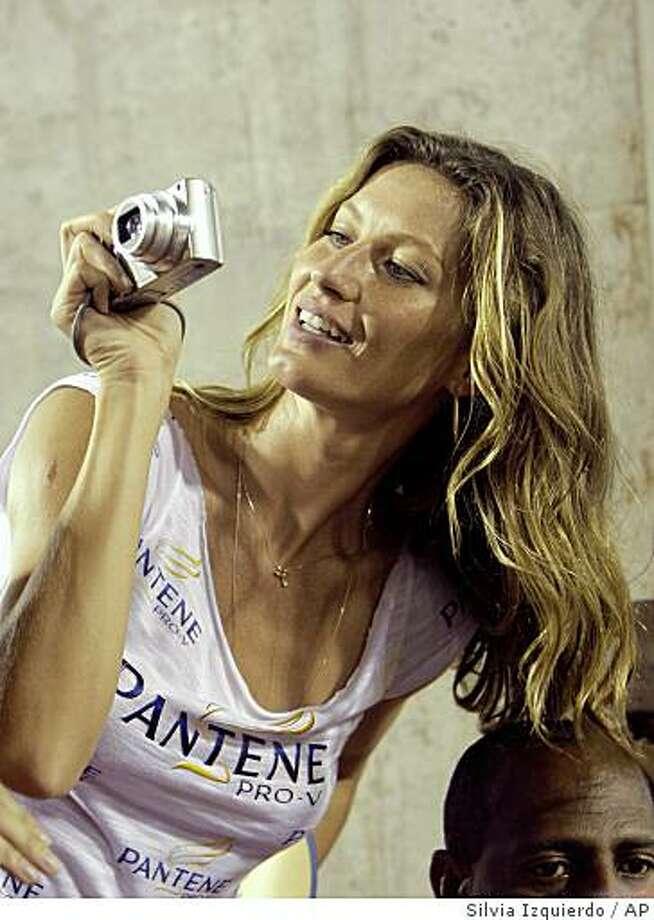 Brazil's top model Gisele Bundchen takes photos during Sunday's carnival parade at the Sambodrome in Rio de Janeiro, Sunday, Feb. 22, 2009.(AP Photo/Silvia Izquierdo) Photo: Silvia Izquierdo, AP