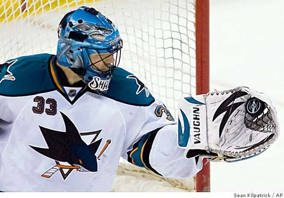 San Jose Sharks' Brian Boucher makes a save against the Ottawa Senators in third-period NHL hockey game action at the Scotiabank Place in Ottawa on Thursday, Feb. 26, 2009. The Sharks defeated the Senators 2-1. (AP Photo/The Canadian Press,Sean Kilpatrick) Photo: Sean Kilpatrick, AP