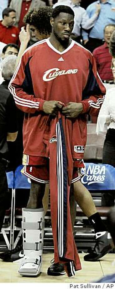Cleveland Cavaliers' Ben Wallace stands on the sidelines with his leg in a cast during the second half of an NBA basketball game against the Houston Rockets on Thursday, Feb. 26, 2009, in Houston. Houston won 93-74. (AP Photo/Pat Sullivan) Photo: Pat Sullivan, AP