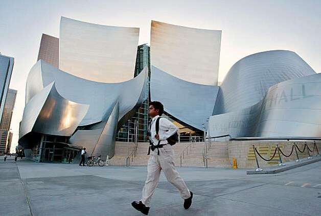 A man walks past Walt Disney Concert Hall in downtown Los Angeles. Photo: Kevork Djansezian, AP