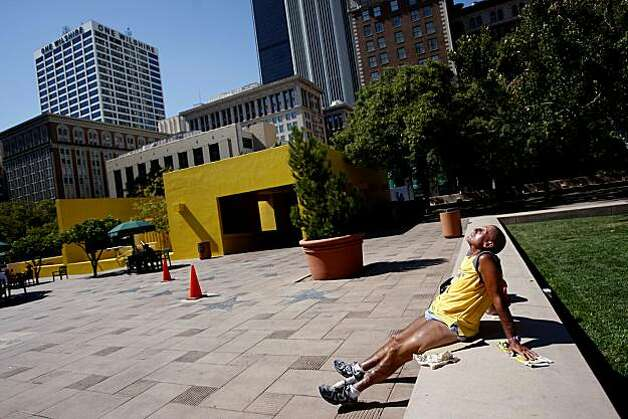 Michael Higgins, 64, works on his tan in Pershing Square in downtown Los Angeles, California, Monday, September 27, 2010. Photo: Genaro Molina, Los Angeles Times/MCT