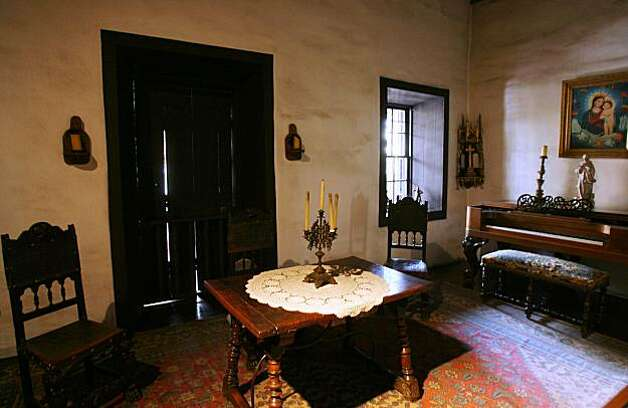 A view is shown of the living room of the Avila Adobe, the oldest existing house in Los Angeles, California. Photo: 2006